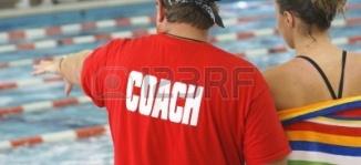 1478281-un-entrenador-de-natacion-con-su-estudiante