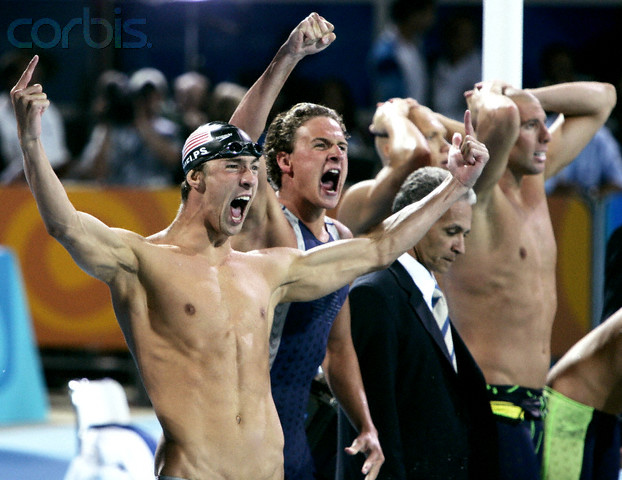 17 Aug 2004, Athens, Attica, Greece --- Michael Phelps (L) and Ryan Lochte (2ndL) of the U.S. celebrate their gold medal in the men's 4x200 freestyle relay while Australia's Grant Hackett (R) and an unidentified team-mate react behind them at the Athens 2004 Olympic Games August 17, 2004. --- Image by © Jerry Lampen/Reuters/Corbis