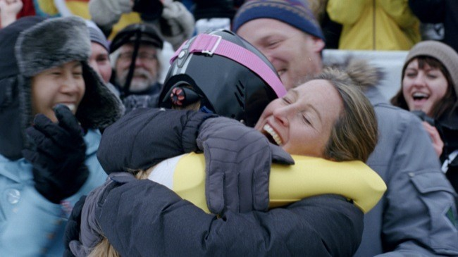 Image from Pick Them Back Up. Athlete and Mom Embrace