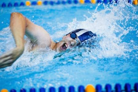 14872796-male-professional-competitive-swimmer-in-swimming-pool