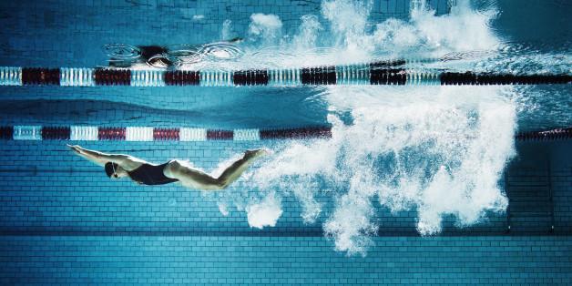 Female swimmer underwater in pool